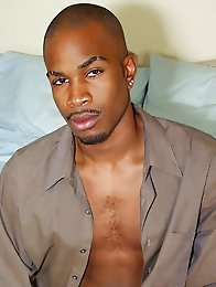 Black gay strip and poses in bedroom
